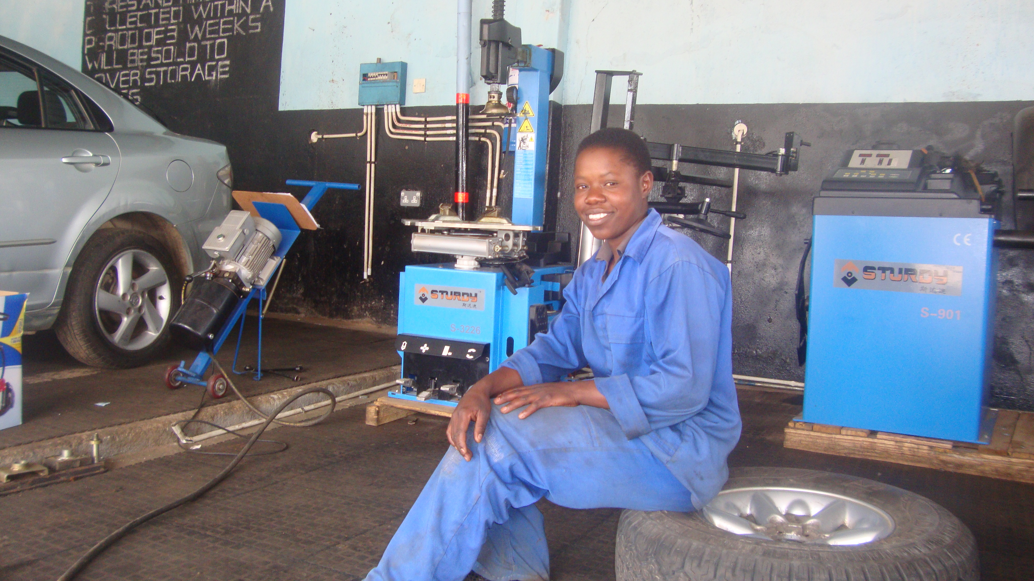Giveth Mambo pictured in the garage in Harare, Zimbabwe where she works