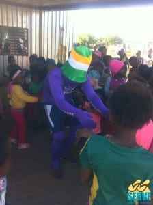 Aaron entertaining the children at Mpho Kunou on Madiba Day
