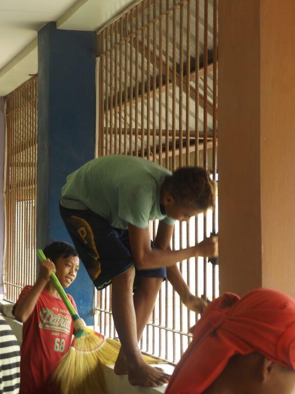 young Badjao boys helping to clean the school (Medium)