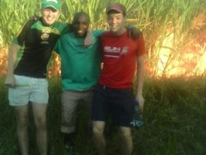 Students from Coláiste Feirste with SERVE leader Vernam Timbini at sugar cane plantation