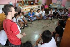 Fiachra facilitating drama workshops with high school Badjao students