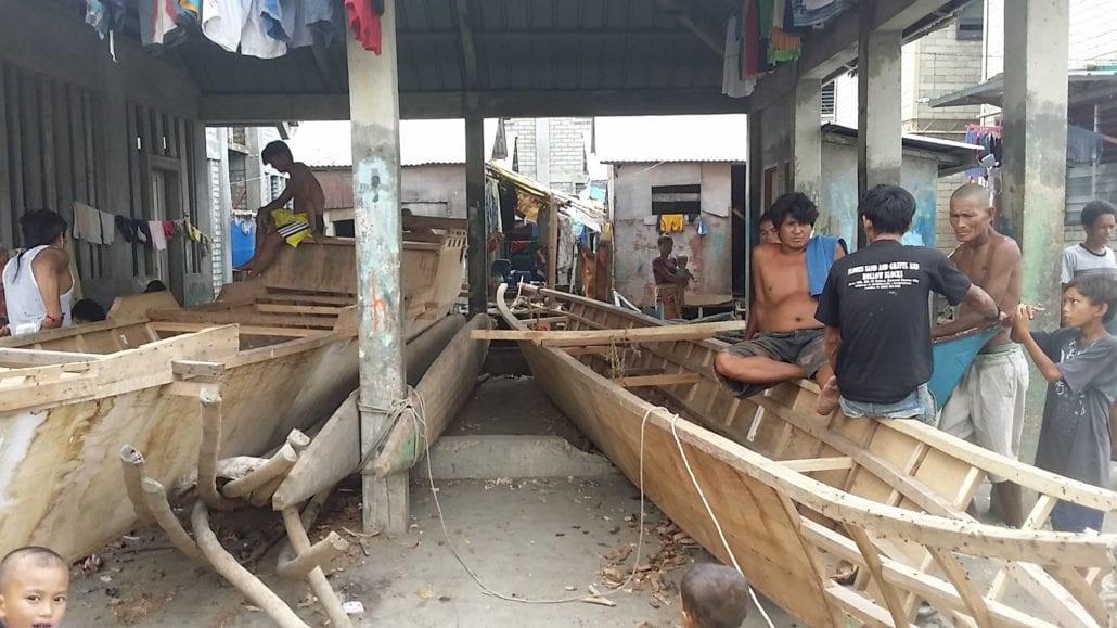 Badjao men working on their boats