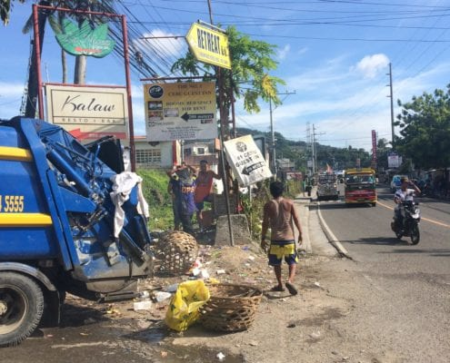 Cebu City waste collectors clear piles of rubbish from the side of the street. Pollution is one of the most obvious and shocking issues in the city. It is encouraging to see that they are working to solve this problem. Photo: Étáin Collins