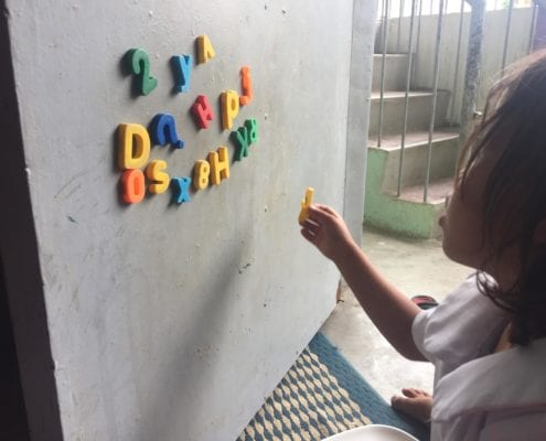 This is a child from the Badjao Montessori class. Magnets are used to improve the children's letter and number-sense. The materials used in the Badjao Montessori class are identical to any Montessori class, in any developed country around the world. Education has become the pride of the Badjao tribe, contrary to the belief that education is not of importance in developing countries and societies, and this is illustrated through each child's participation and enthusiasm in their lessons. Photo: Brónagh Hogan